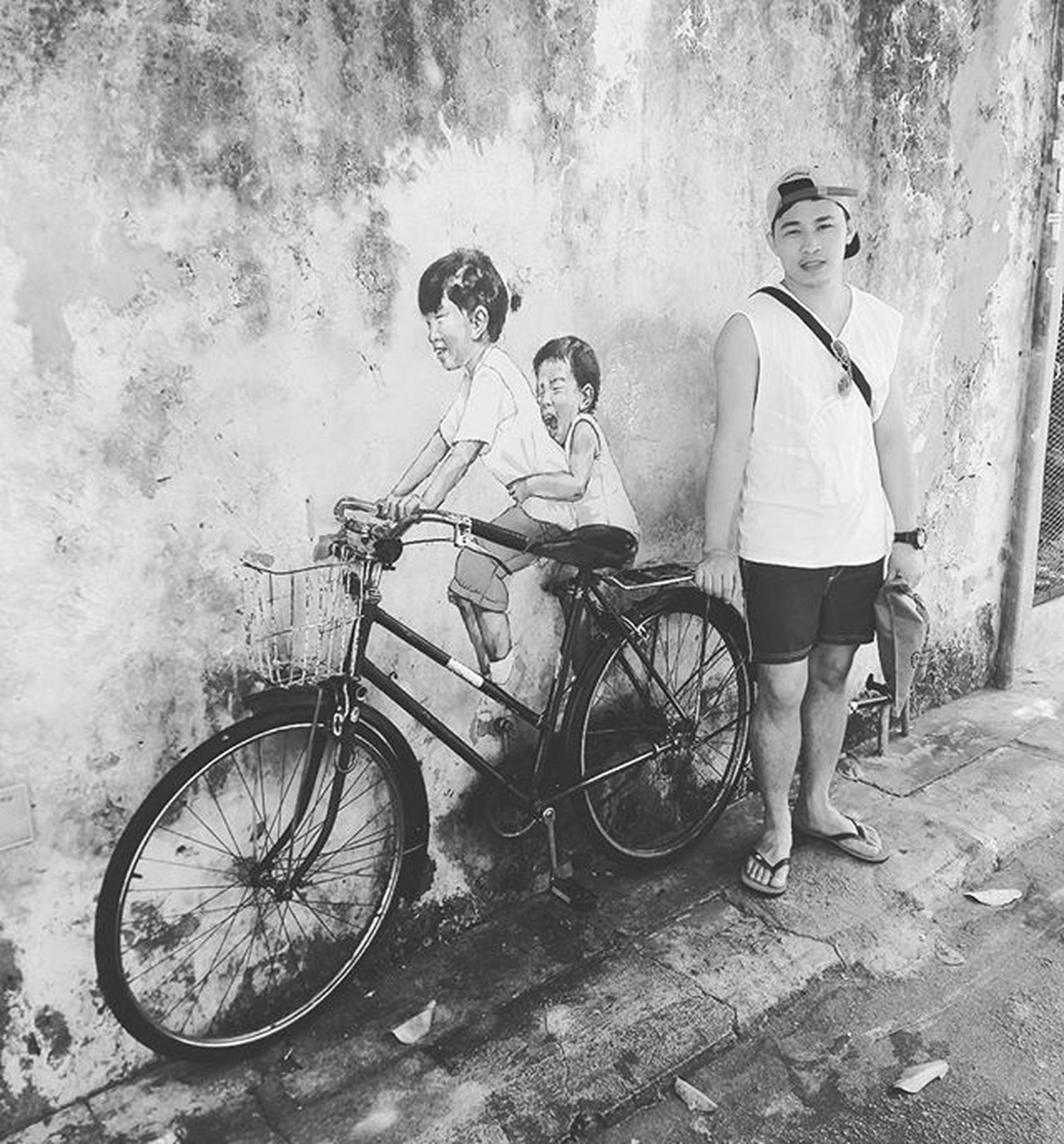 bicycle, lifestyles, full length, casual clothing, leisure activity, person, boys, land vehicle, childhood, mode of transport, elementary age, transportation, side view, men, girls, young adult, street, standing