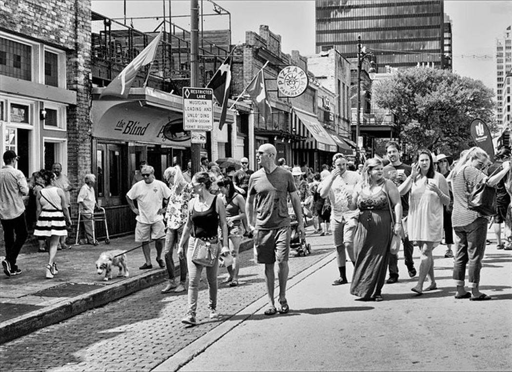 The Walkers. Large Group Of People Outdoors Walking City Life Casual Clothing Street Crowd Streetpgotographer City Life Austin Texas Texas!!!! Hdr_captures Medium Group Of People Black And White Collection  Blaxkandwhite Blackandwhite Photography
