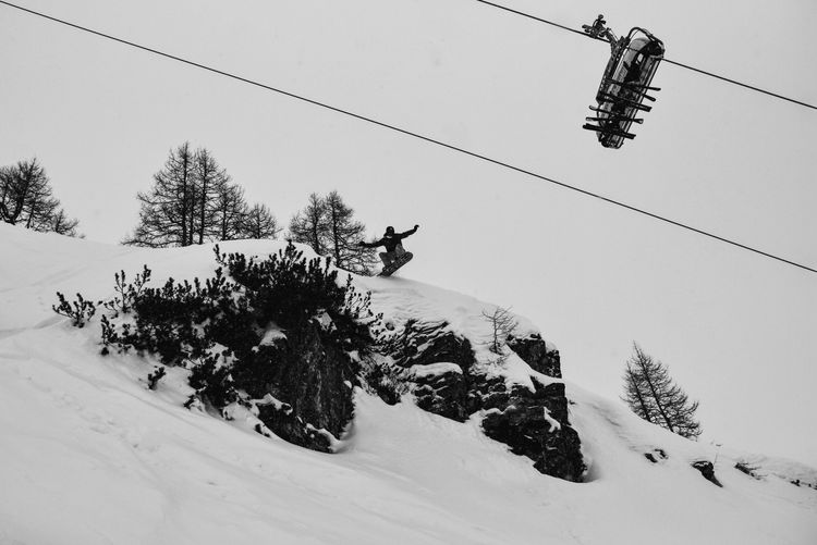 Step It Up TakeTheLeap IntoTheUnknown........ ................... Cable Tree Winter Overhead Cable Car Nature Low Angle View Cold Temperature Outdoors Snow Day Transportation Real People Sport Ski Lift Full Length Sky (null)Cloud - Sky Nature Skiing Sending Snowboarding