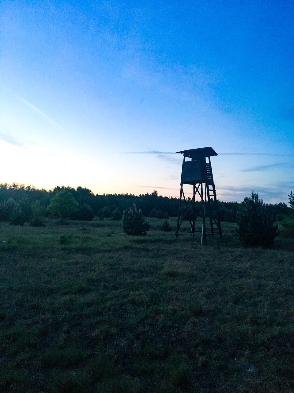 silhouette, sky, field, grass, nature, landscape, tree, sunset, lookout tower, outdoors, no people, tranquility, beauty in nature, day, scenics, water tank, built structure, clear sky, water tower - storage tank, architecture