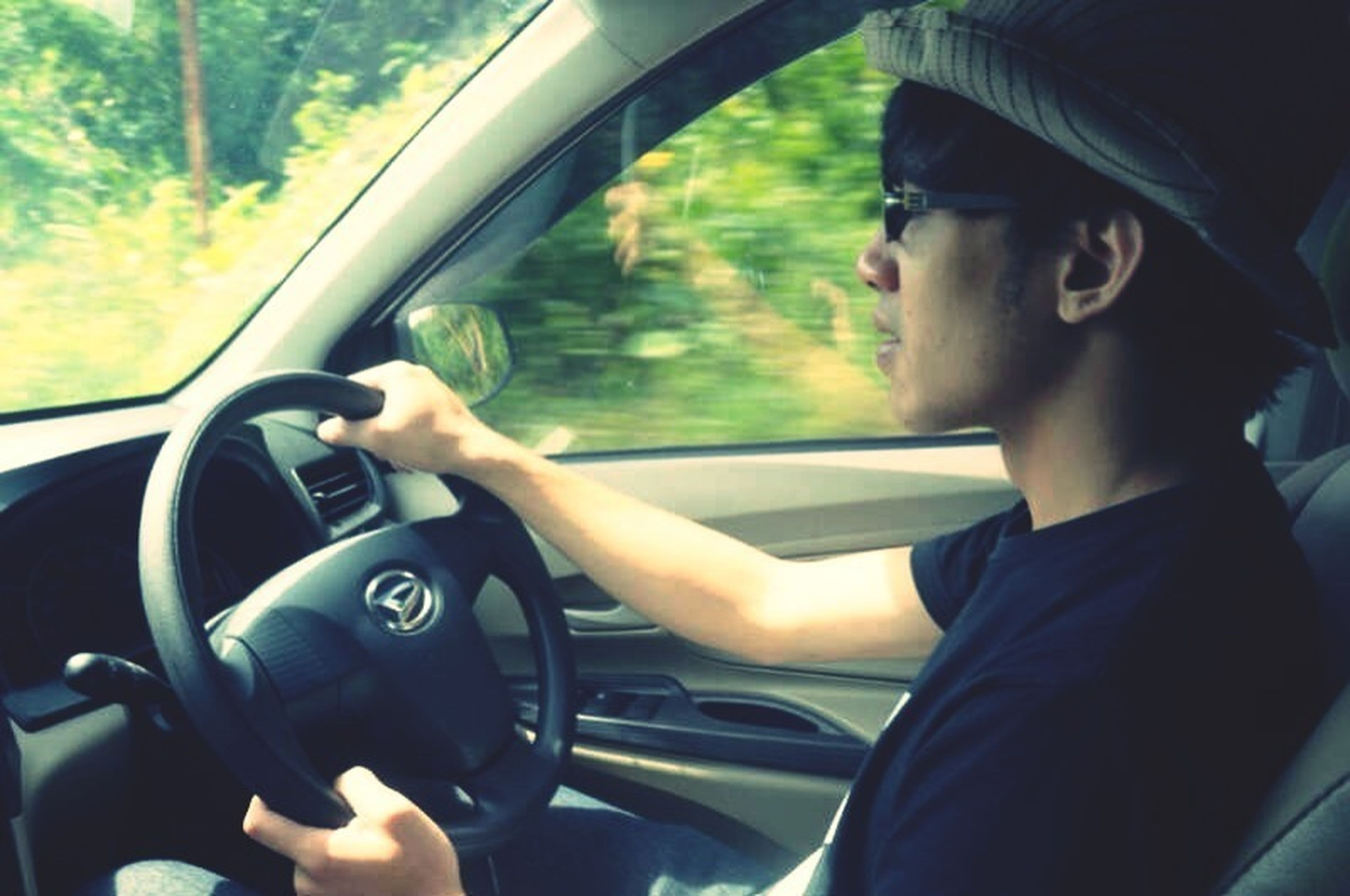 transportation, mode of transport, land vehicle, car, vehicle interior, car interior, travel, part of, steering wheel, side-view mirror, driving, lifestyles, journey, windshield, leisure activity, glass - material, window, cropped