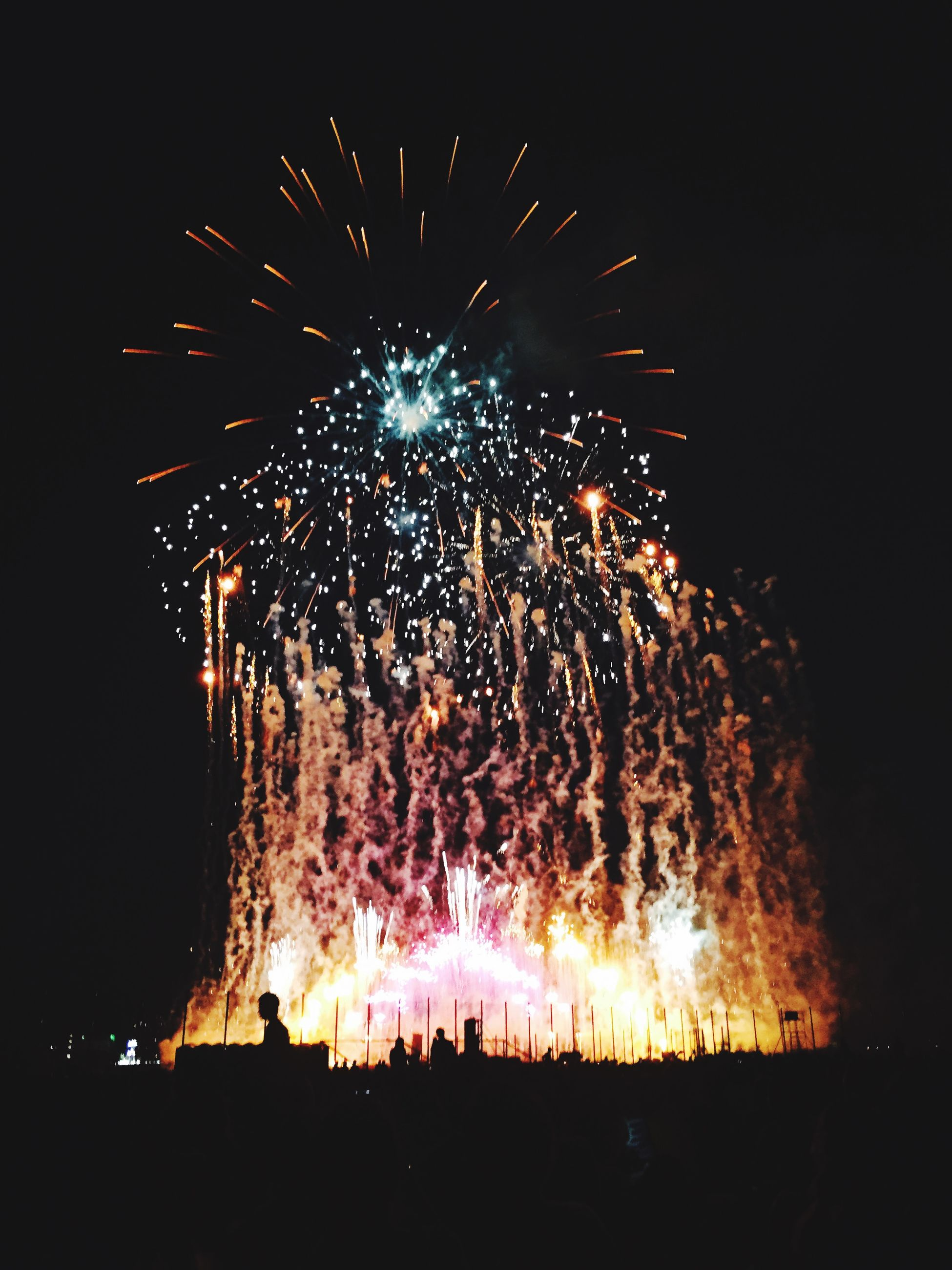 night, firework display, illuminated, exploding, long exposure, celebration, arts culture and entertainment, firework - man made object, motion, sparks, event, glowing, blurred motion, entertainment, firework, fire - natural phenomenon, sky, celebration event, smoke - physical structure, low angle view