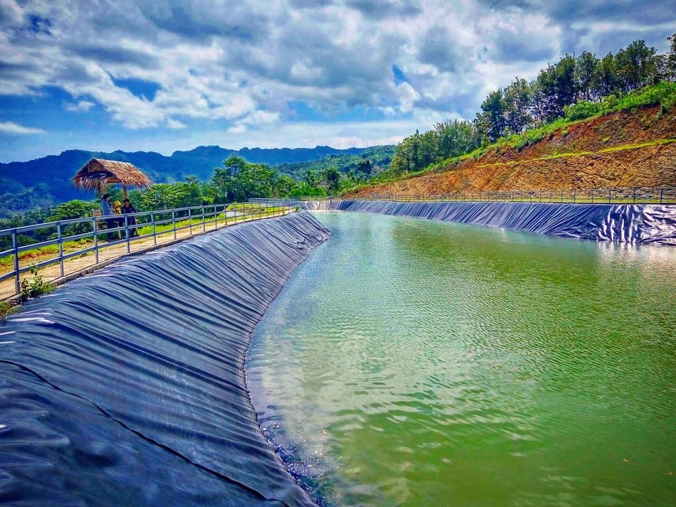 Water Sky Mountain Tranquil Scene Cloud - Sky Tranquility Scenics Nature Beauty In Nature Non-urban Scene Outdoors Day Growth Long Mountain Range Flowing Water Multi Colored Stone Material Surface Level Remote