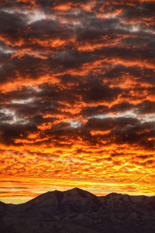 Sunset over the western mountains. Some amazing colors in the sky recently. Sunset Beauty In Nature Scenics Orange Color Cloud - Sky Nature Dramatic Sky Tranquility Sky Outdoors Landscape Fine Art Photography Nikon Light Beauty In Nature Sandy Utah Utah Snow