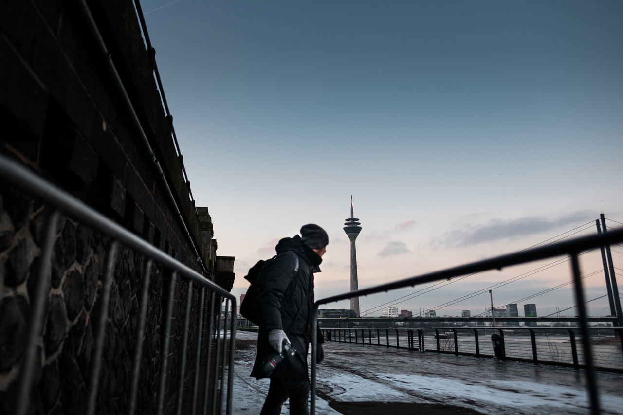 On the hunt: at Rheinufer promenade in Duesseldorf, Germany. architecture photography Blue Hour blue sky city photography cold day Deutschland Düsseldorf early morning Exploring fujifilm germany Morning outdoors rheinturm river Riverside sky street photography sunrise sunset television tower Wall wide angle X-T10