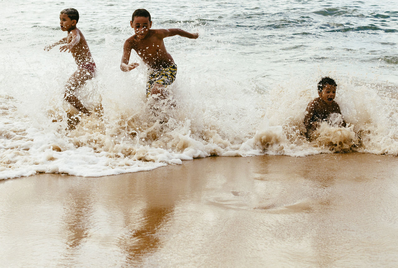 Bahia Beach Enjoyment Friendship Fun Happiness Kids Being Kids Leisure Activity Live For The Story Motion Porto Da Barra Salvador Bahia Sand Sea Speed Splashing Vacations Water Young Adult Young Men