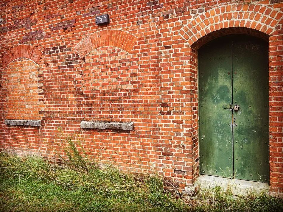 Green Doorway Bricked Up Windows Ancient Monument Architecture Brick Brick Wall Building Exterior Built Structure Closed Day Defensive Fighting Position Defensive Structure Doorway Entrance Exterior Grass Green Color Hilsea Lines Hilsea Lines Ramparts No People Old Orange Color Outdoors Portsea Island Ramparts Red The Castlemates