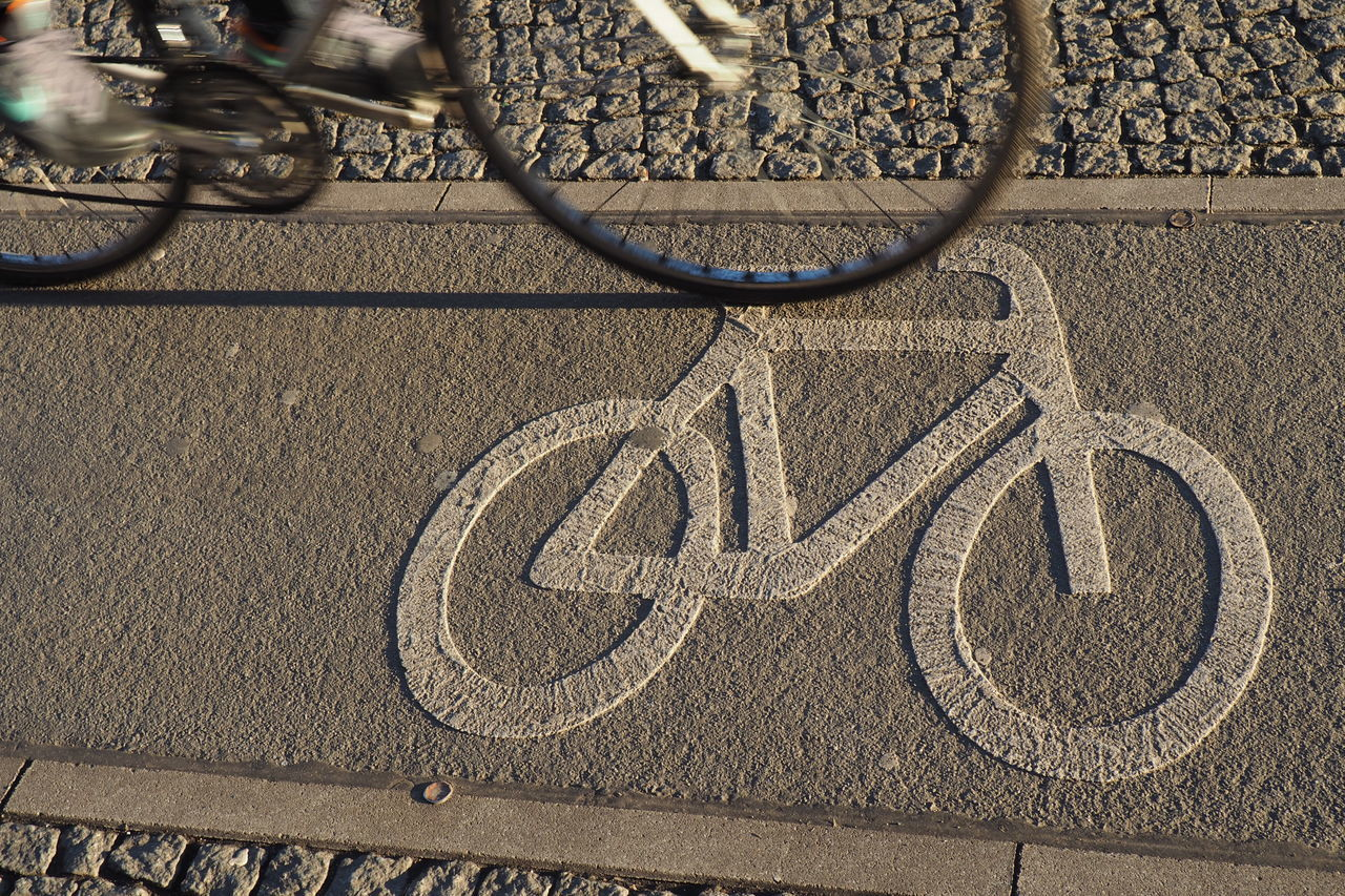 Low Section Of Person Riding Bicycle On Lane