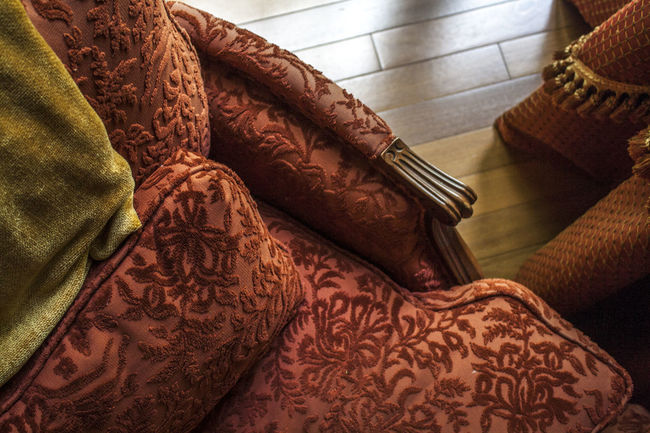 Blanket Comfy  Fabric Gold And Red Hardwood Floor Home Decor Home Design Homey Interior Design Looking Down Mixed Textures Mustard Yellow Reading Time Red Chair Side Table Textile Upholstered Upholstered Chair Velvet Warm Colors Window Light