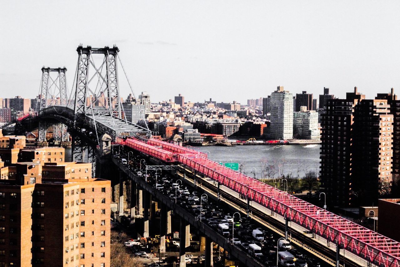 architecture, built structure, building exterior, city, transportation, outdoors, cityscape, clear sky, bridge - man made structure, no people, day, water, sky, skyscraper