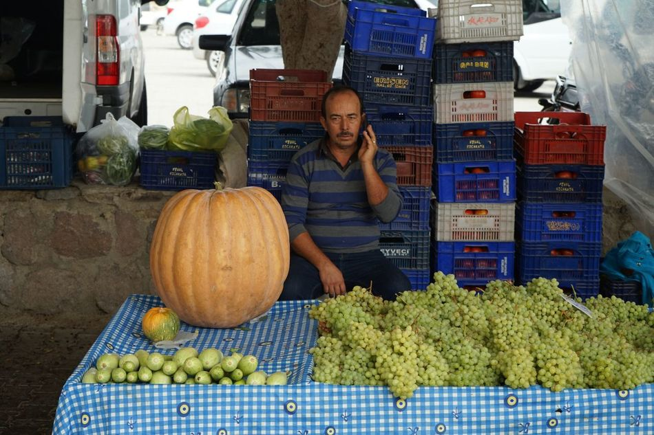 Happy Halloween Its Business TimeOn The Phone Best Shots Story Big Pumpkins Business Grapes Market Sales Call Sales Eyeem You Are He She It Is People Bussiness The Street Photographer - 2016 EyeEm Awards