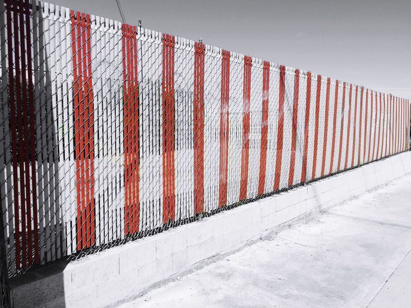 """Red Slat Win"" Slat fence near First Street Bridge in Barstow, California. Fence Slats Route 66 Selective Color Selectivecoloring Selective Colorization Blackandwhite Blackandwhitephotography"