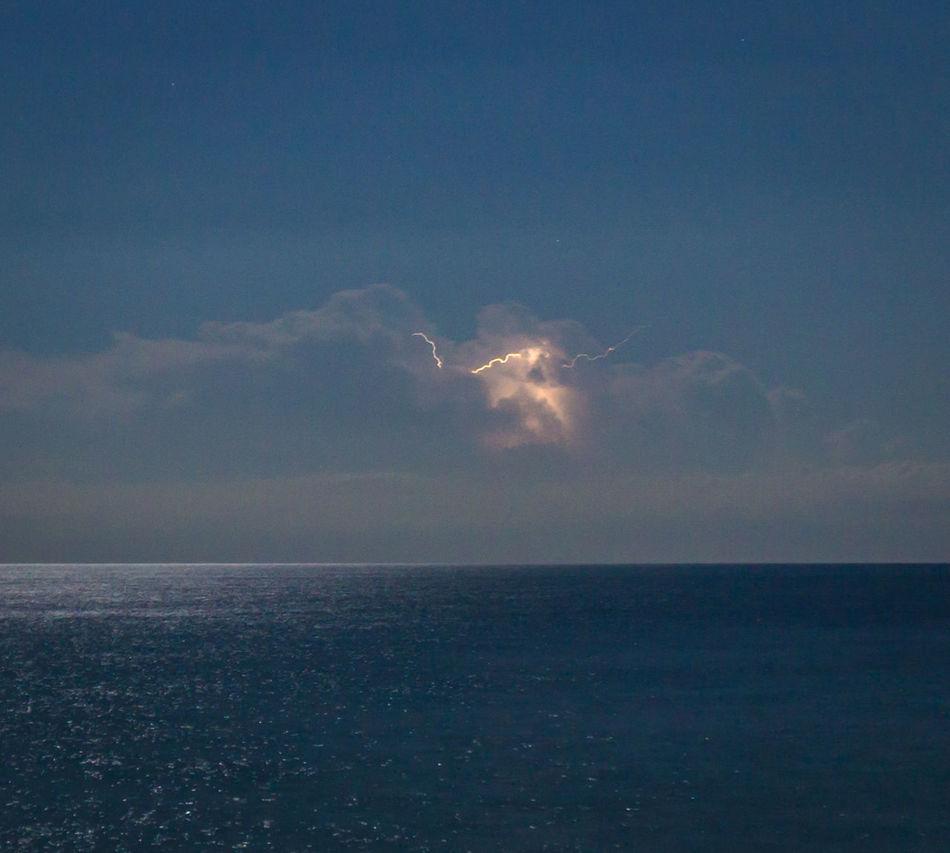 Beauty In Nature Blue Calm Cloud Cloud - Sky Cloudy Horizon Over Water Lightning Long Exposure Majestic Nature No People Ocean Outdoors Phosphorescence Scenics Sea Sea And Sky Seascape Sky Storm Cloud Tranquil Scene Tranquility Water Waterfront