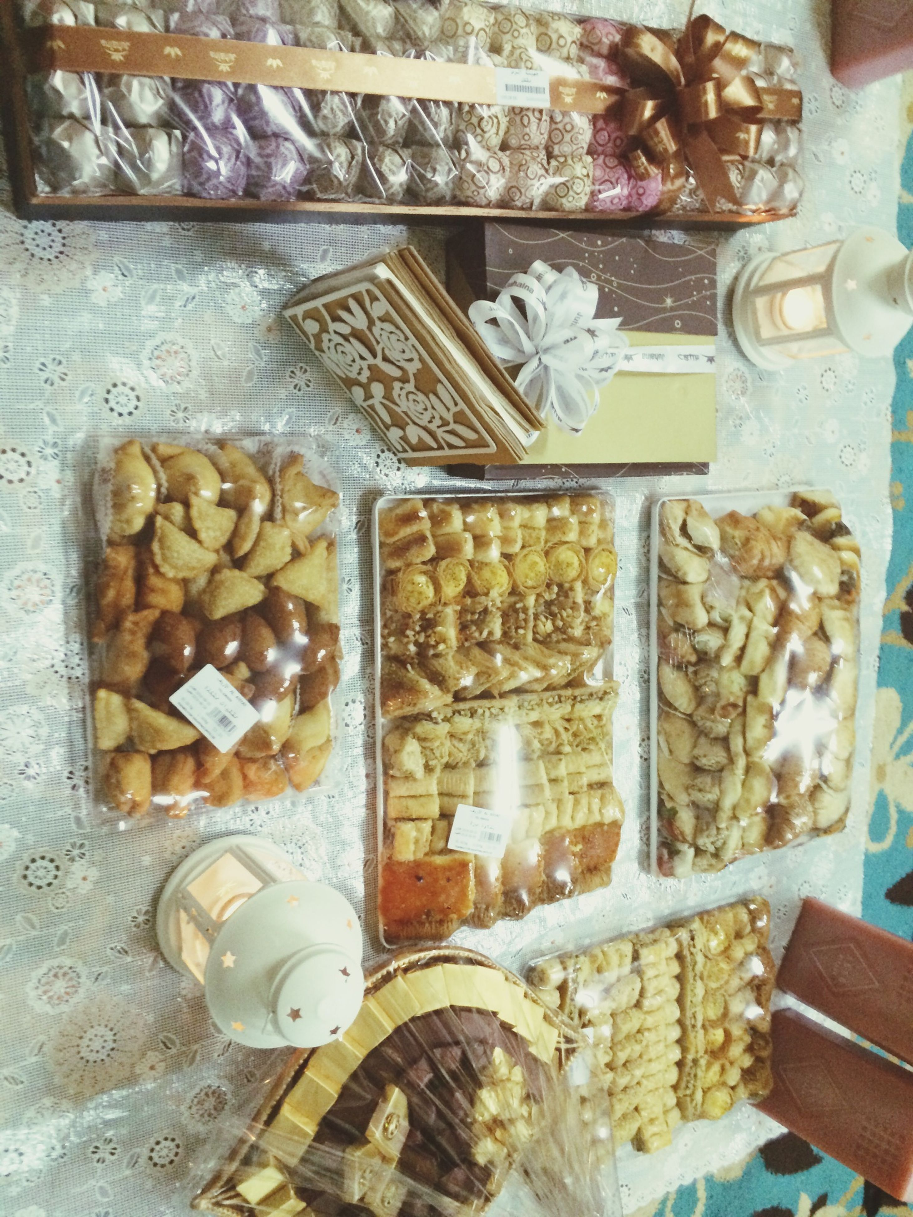indoors, still life, large group of objects, abundance, variation, table, food and drink, wood - material, for sale, retail, food, text, high angle view, choice, arrangement, no people, close-up, stack, collection, art and craft