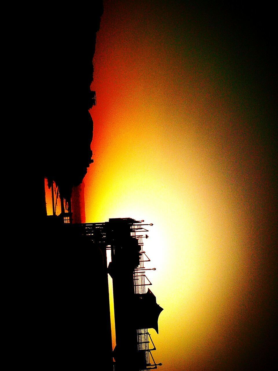 sunset, silhouette, clear sky, orange color, sky, architecture, built structure, low angle view, nature, sun, outdoors, building exterior, scenics, beauty in nature, no people, day