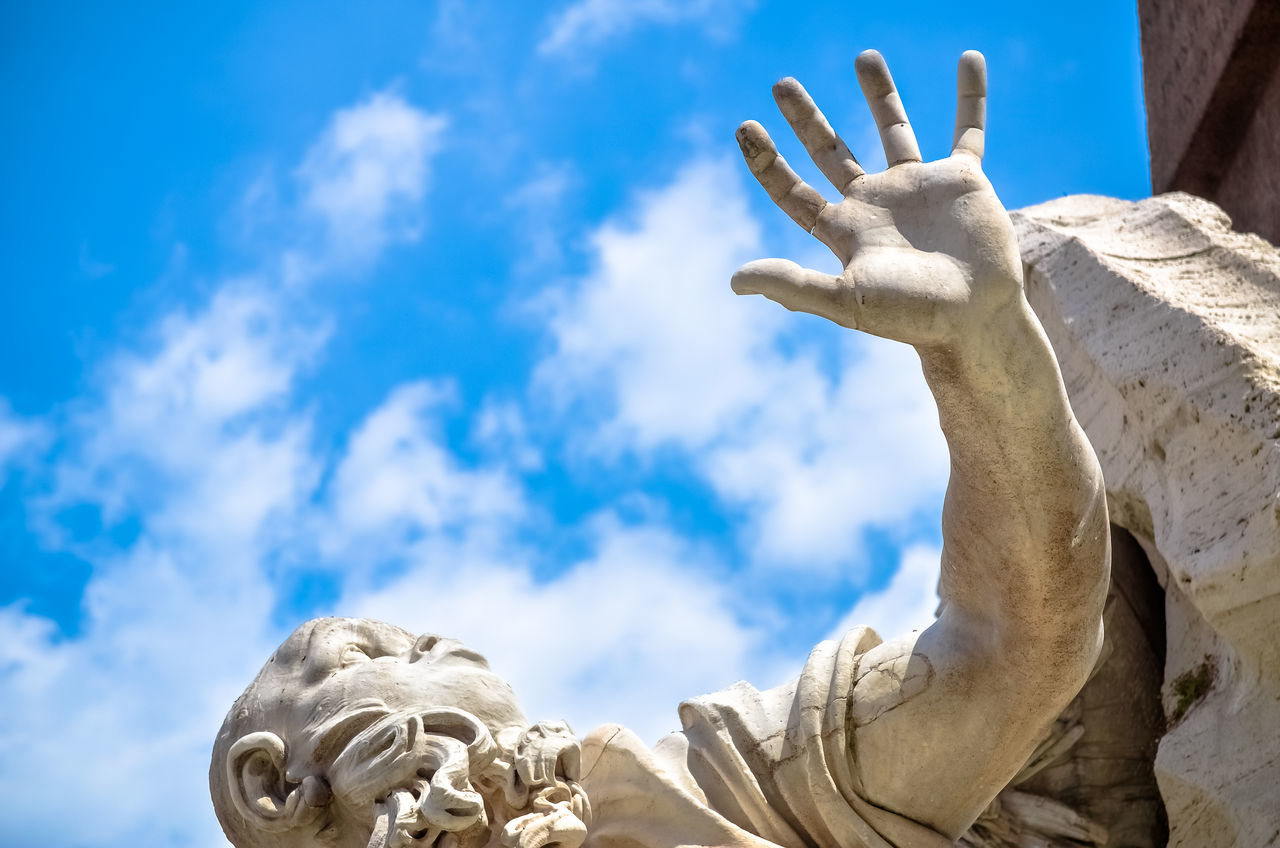 Statue of Bernini's Fountain of the Four Rivers in the Piazza Navona, Rome - detail of the allegorical Ganges figure Art Bernini Blue Cloud - Sky Day Fountain Italy Landmark Marble Nature Navona No People Outdoors Piazza Navona Rome Italy Sculpture Sky Statue Sun