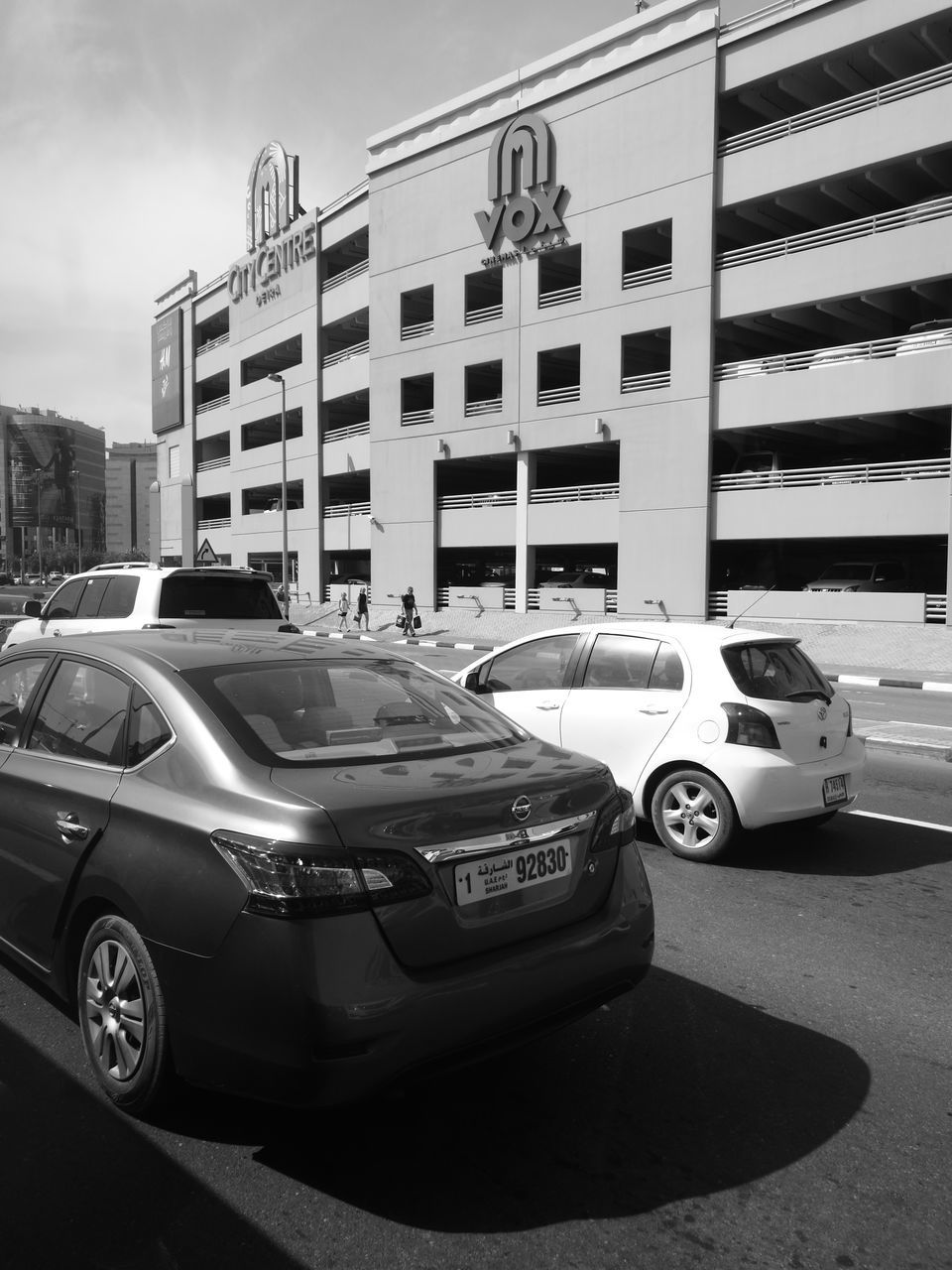 car, transportation, land vehicle, building exterior, architecture, built structure, mode of transport, city, outdoors, day, modern, no people