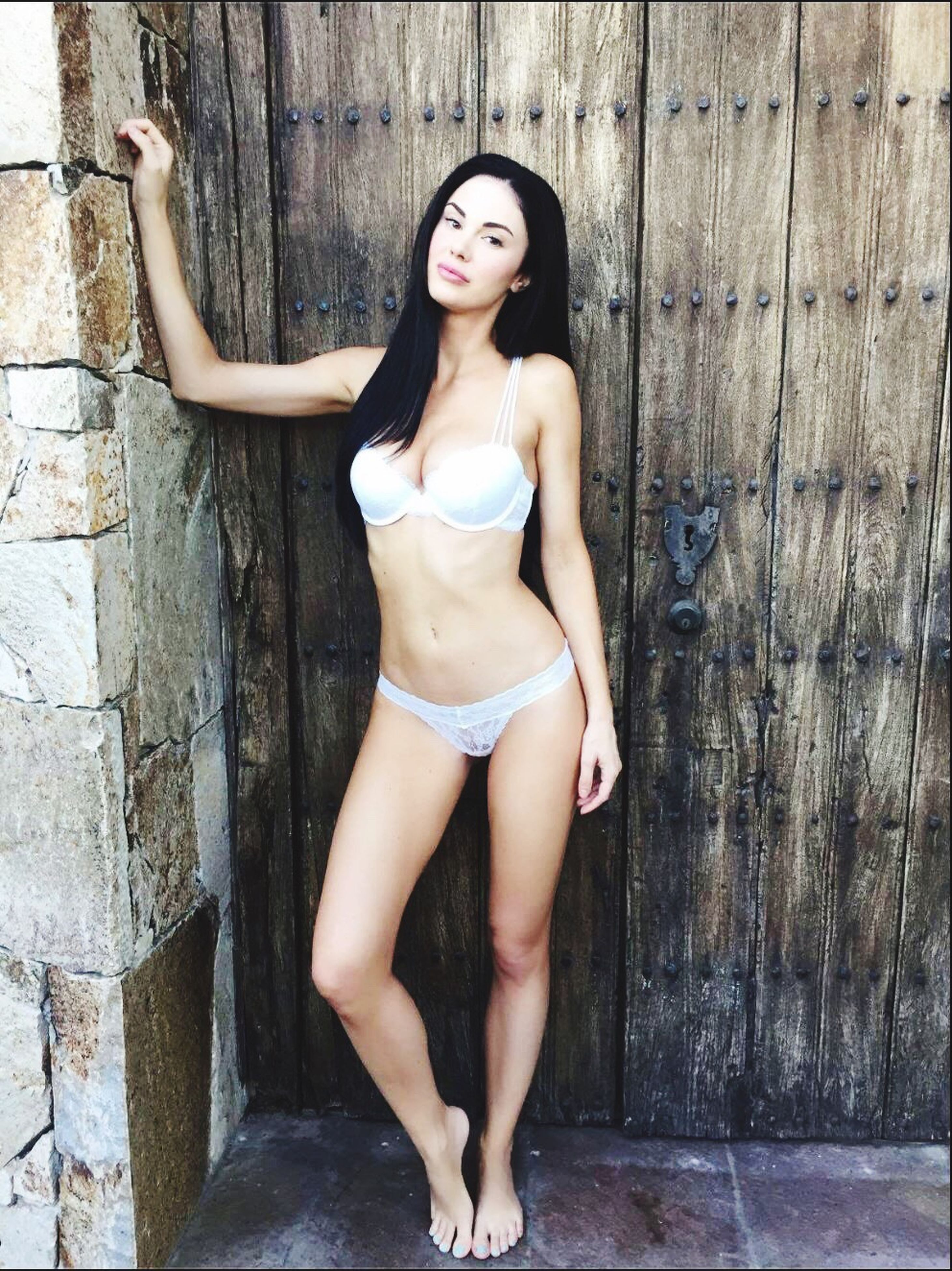 beautiful woman, young adult, long hair, standing, one person, lifestyles, day, beauty, black hair, only women, young women, real people, full length, outdoors, one young woman only, adult, people, hot pants, adults only