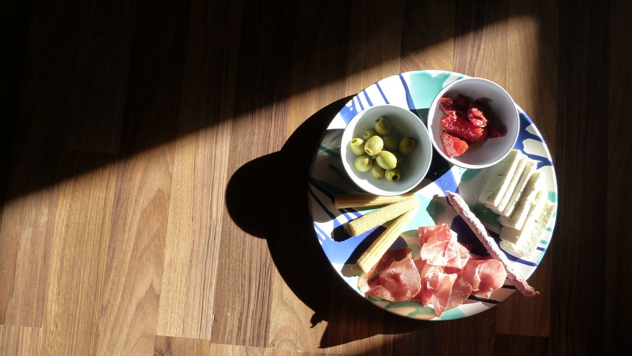 Close-up Freshness Light And Shadow Plate Ready-to-eat Served Still Life Healthy Lifestyle Foodporn Food Porn Kitchen Indulgence Healthy Eating Dramatic Angles Multi Colored Arrangement Sunlight Dried Tomatoes Parmesan Feta Serrano Color Of Life Interior Style A Bird's Eye View Light And Reflection