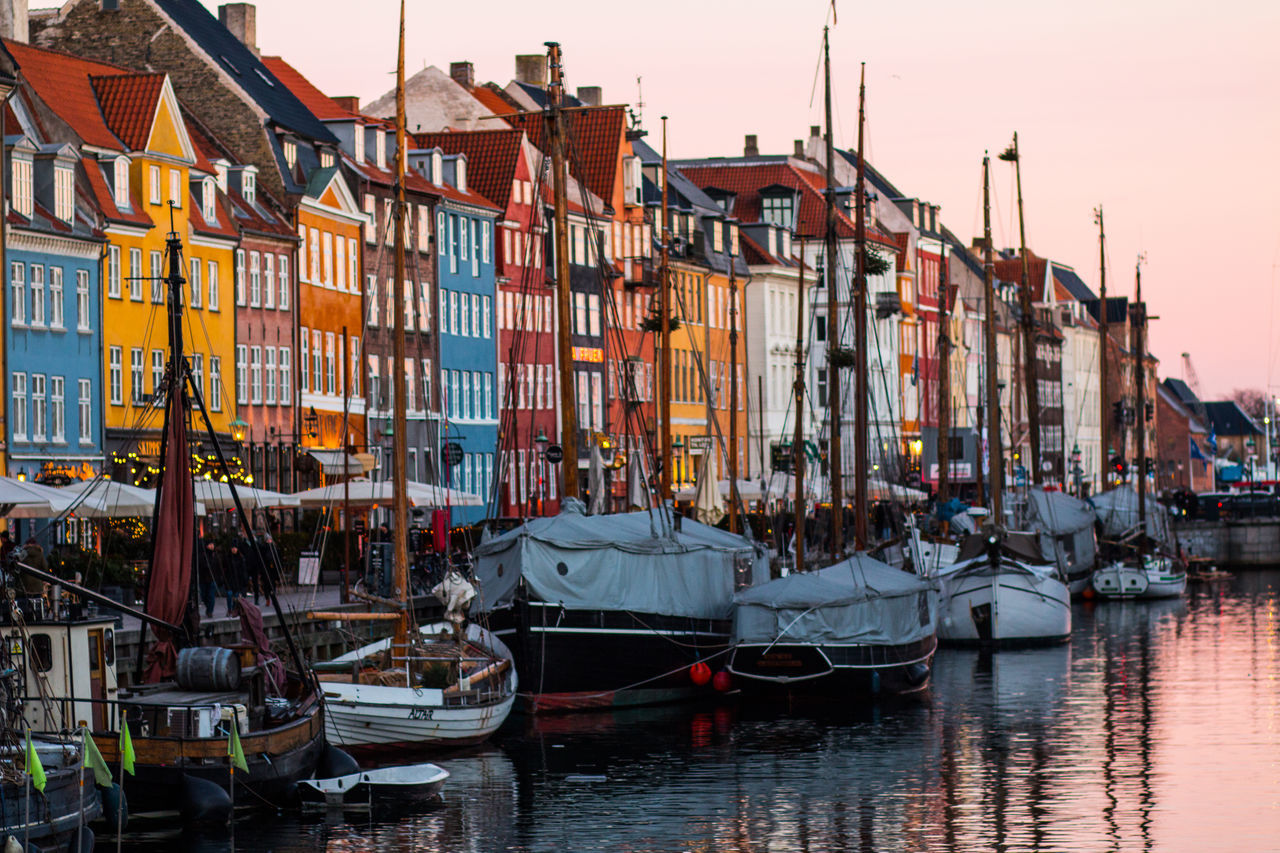 COPENAGHEN - JAN 06, 2017: Beautiful view of Nyhavn at sunset. Nyhavn is a 17th-century waterfront, canal and entertainment district in Copenhagen, Denmark. Architecture Boat Building Exterior Canal City Copenhagen Danmark Day EyeEm Best Shots Globetrotter Gondola - Traditional Boat Harbor Nautical Vessel Outdoors Panorama Scandic Scandinavia Sky Sunset Sunset_collection Transportation Travel Travel Destinations Water