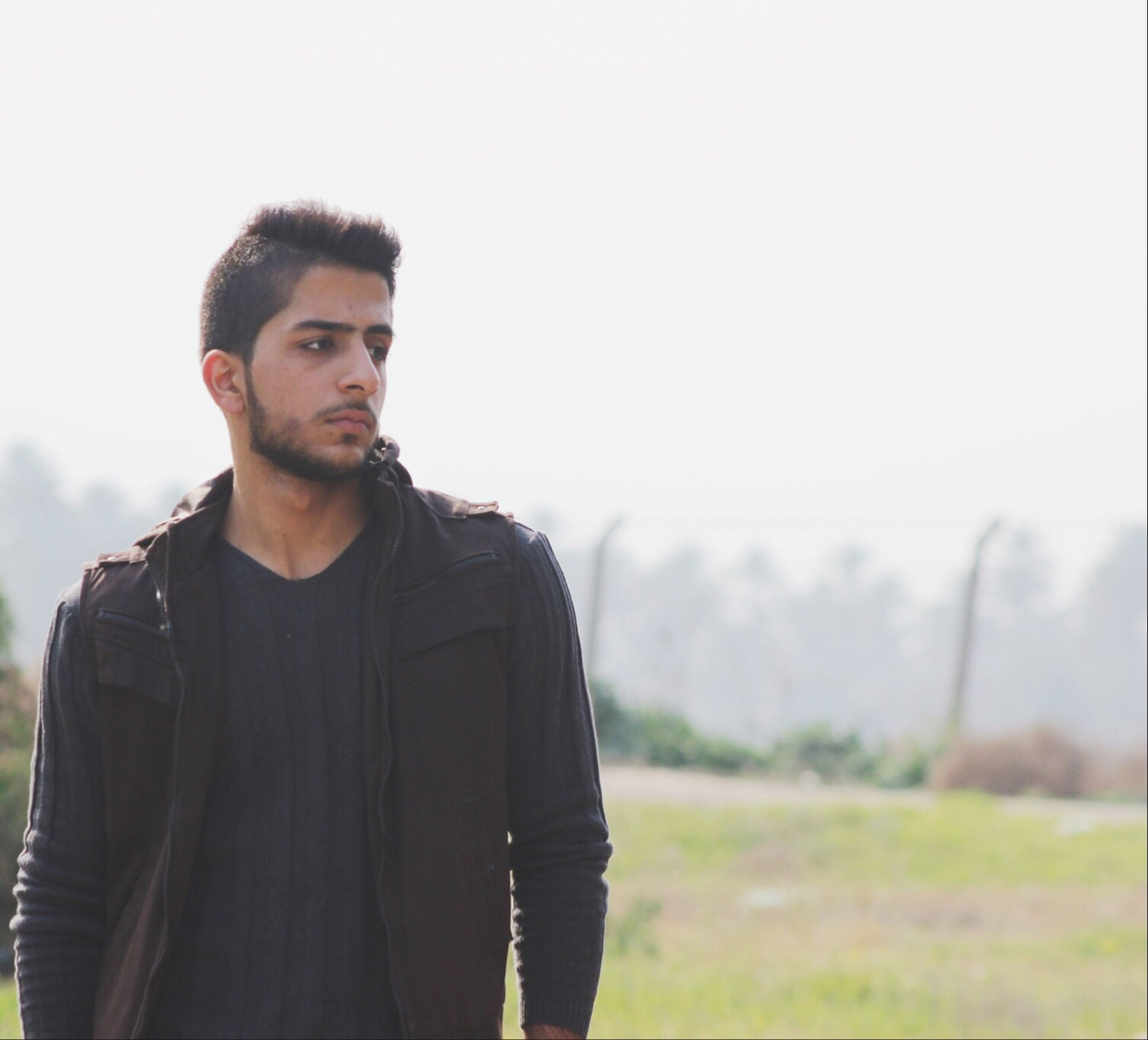 young adult, portrait, lifestyles, young men, looking at camera, casual clothing, person, standing, leisure activity, front view, waist up, smiling, focus on foreground, headshot, three quarter length, copy space, field