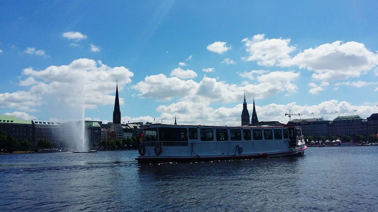 transportation, sky, nautical vessel, mode of transport, architecture, built structure, day, cloud - sky, river, waterfront, water, no people, building exterior, outdoors, ferry, nature, city