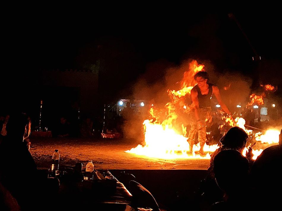 Night Burning Flame Heat - Temperature Real People Arts Culture And Entertainment Men Outdoors Performance Togetherness Leisure Activity Bonfire Large Group Of People Women Only Men Adults Only Adult People Riot Sky