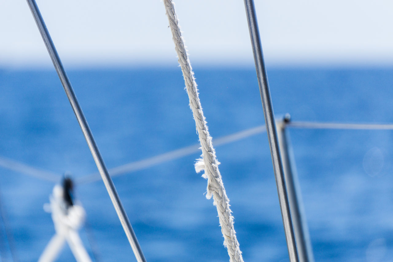Sailboat Shrouds and Ropes with Blurred Sea and Sky Background Blurred Close-up Equipment Fitting Maritime Nature Nautical Vessel Navigation No People Outdoors Riggging Rope Ropes Sailboat Sailboats Shroud Tackle