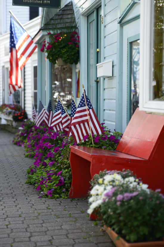 Architecture Bench Building Exterior Built Structure Day Flag Flower Focus On Foreground Footpath No People, Outdoors Outside Red US Flag Vibrant Color