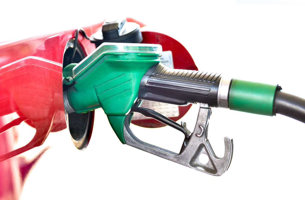 Refueling a red car at the gas station. A truck is being filled with fuel diesel or petrol with green nozzle. Isolated on white. Close-up Day Energy Fossil Fossil Fuel Fossil Fuels Fuel Fuel Pump Gas Gas Station Gasoline Handle No People Outdoors Pumba Red Red Refueling Refueling Truck Refuelingaircraft Station Studio Shot Transportation White Background