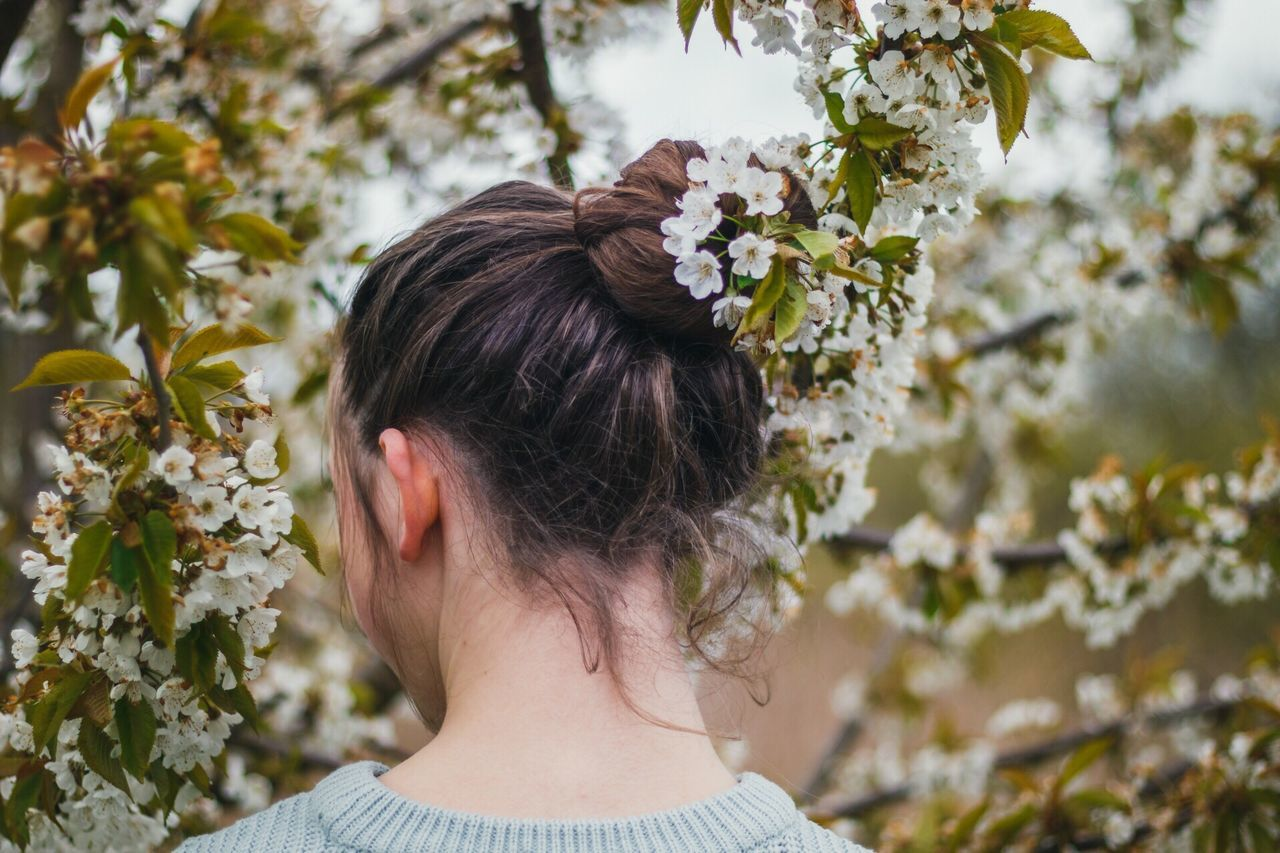 Flower Rear View One Person Hair Bun Real People White Color Blossom Nature Wearing Flowers Tree Outdoors Focus On Foreground Headshot Day Fragility Springtime Growth Beauty In Nature Women Bride The Portraitist - 2017 EyeEm Awards