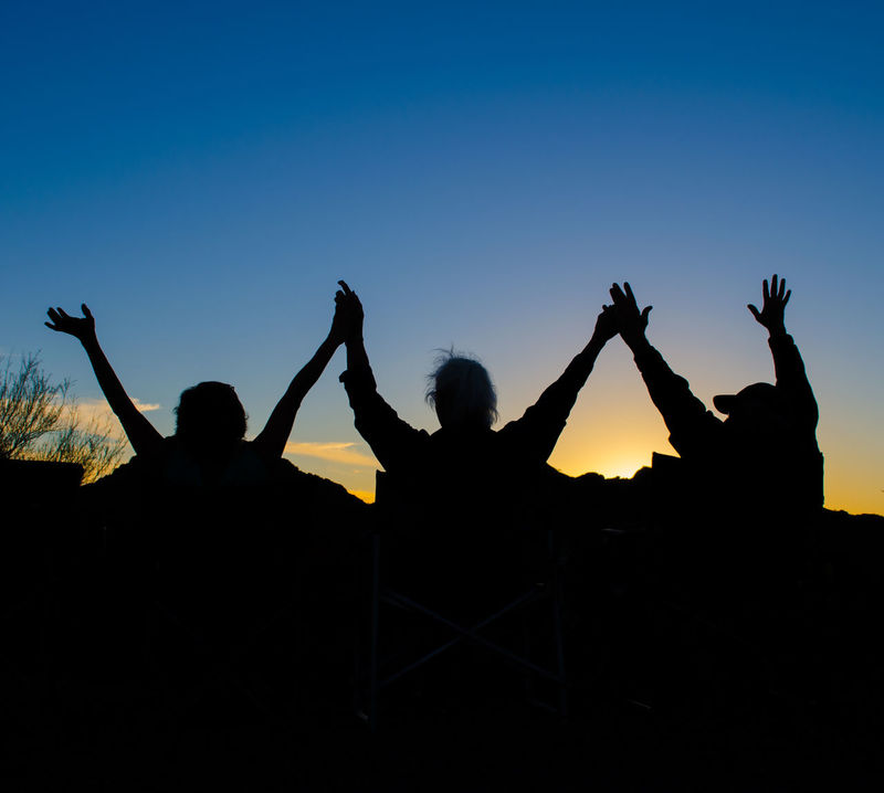 Three People Welcoming the Sunrise Welcome To Black Arms Raised Clear Sky Friendship Human Hand Outdoors People Real People Rear View Silhouette Sky Sunrise Sunset Three Togetherness Women