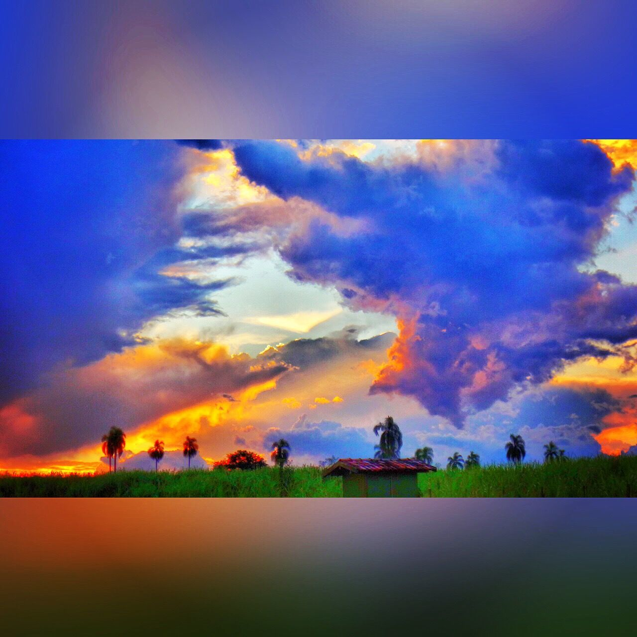 sky, cloud - sky, scenics, outdoors, field, nature, beauty in nature, tranquil scene, tranquility, landscape, sunset, no people, built structure, water, building exterior, day, architecture, grass, tree