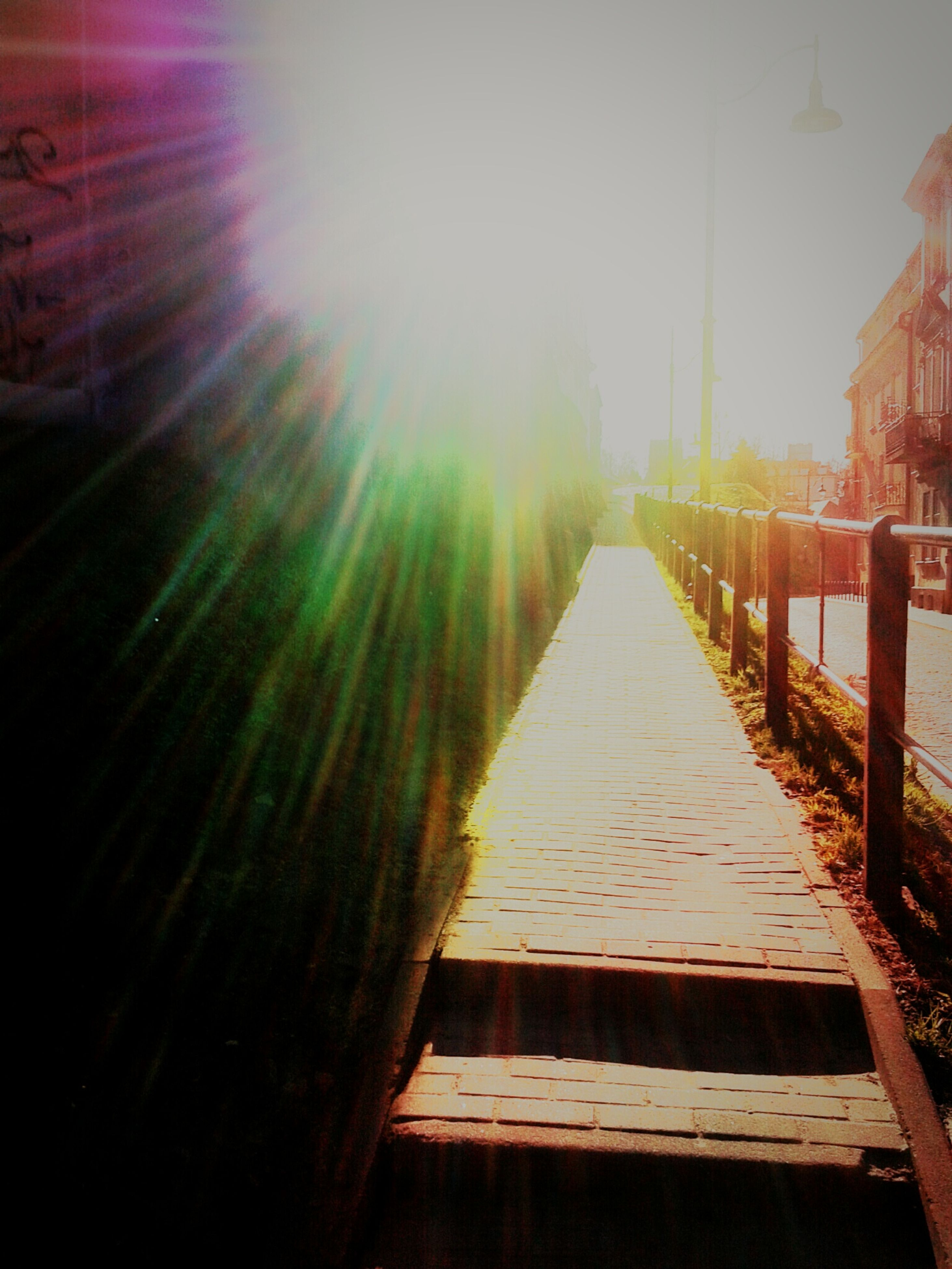 sun, sunbeam, sunlight, the way forward, lens flare, clear sky, diminishing perspective, sunset, wood - material, sky, tranquility, nature, built structure, water, vanishing point, outdoors, railing, sunny, tranquil scene, architecture