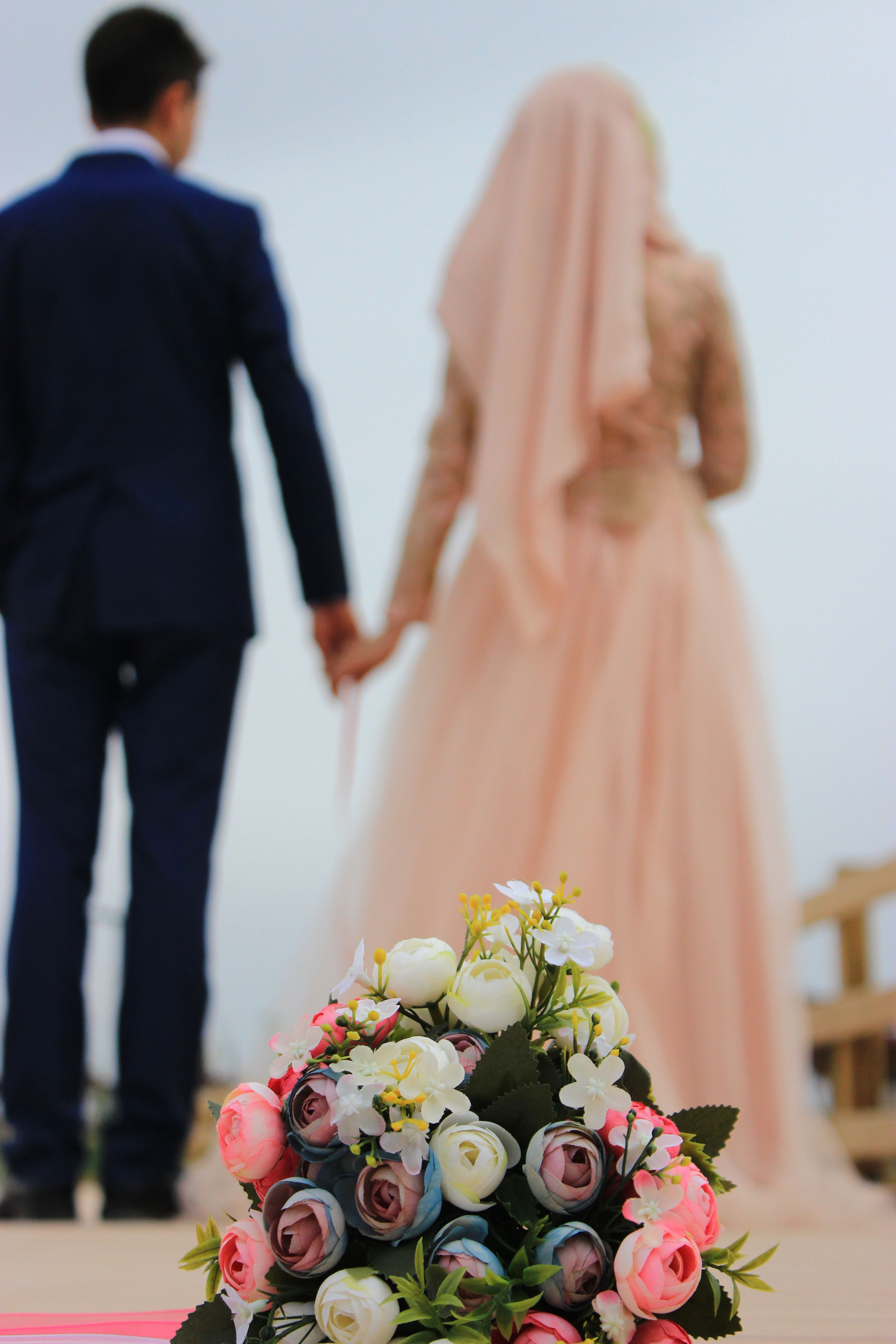 person, holding, indoors, lifestyles, focus on foreground, flower, part of, leisure activity, close-up, cropped, celebration, men, selective focus, creativity, tradition, art and craft