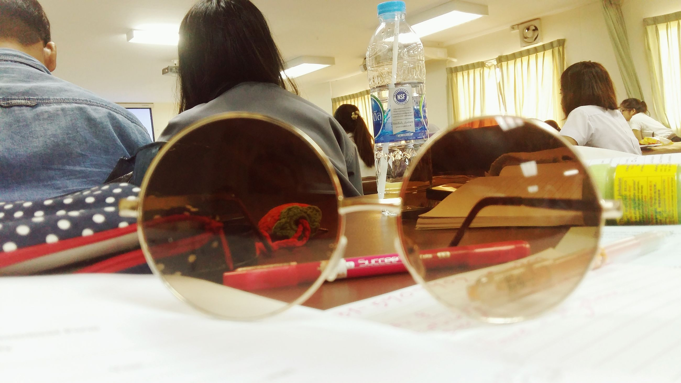lifestyles, leisure activity, food and drink, person, drink, men, refreshment, sitting, table, indoors, incidental people, sunglasses, casual clothing, holding, day, drinking glass, reflection