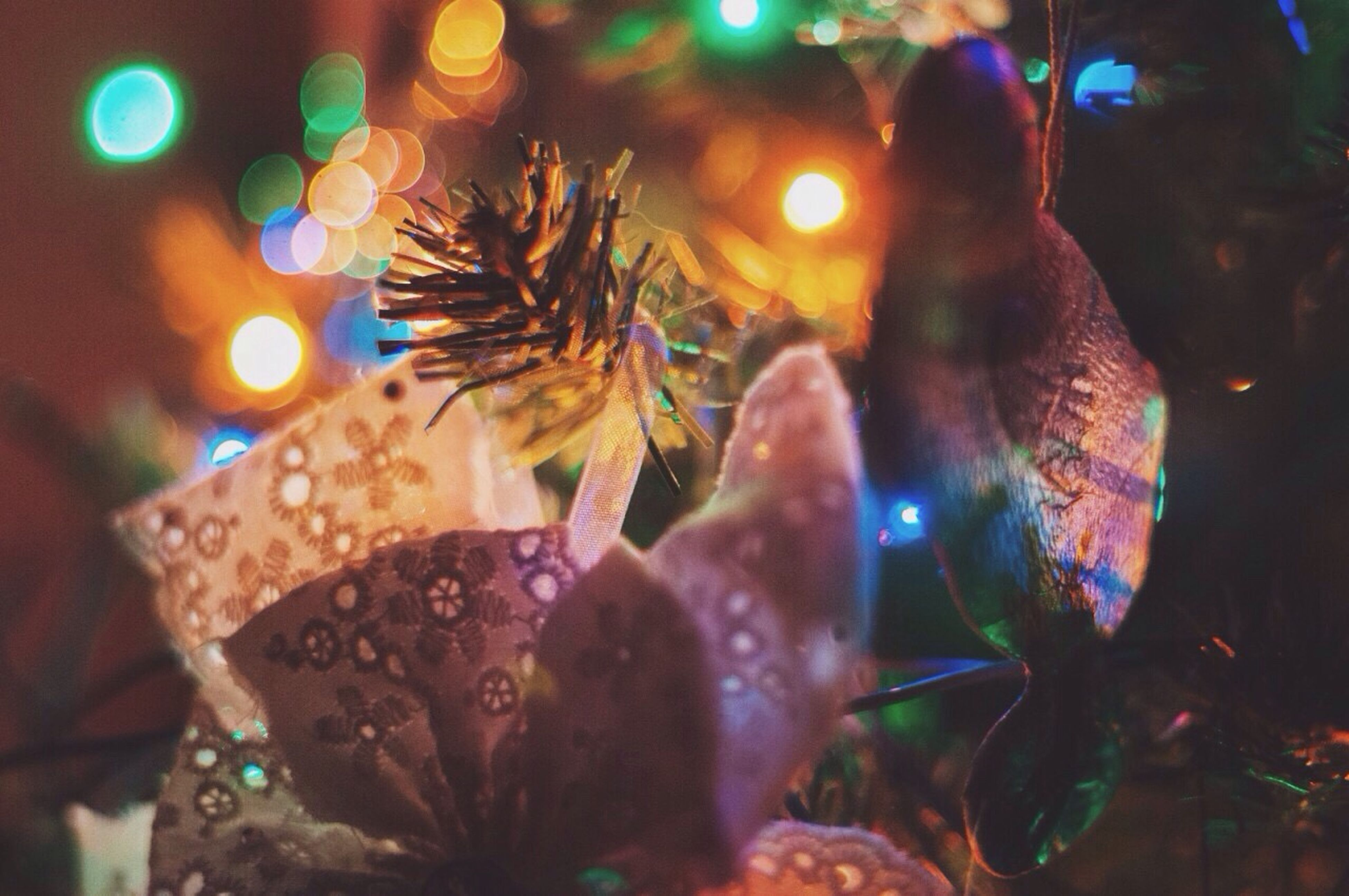 celebration, night, christmas, cultures, illuminated, tradition, christmas tree, close-up, arts culture and entertainment, christmas decoration, christmas lights, christmas ornament, celebration event, party - social event, indoors, nightlife, event, carnival, christmas market, no people