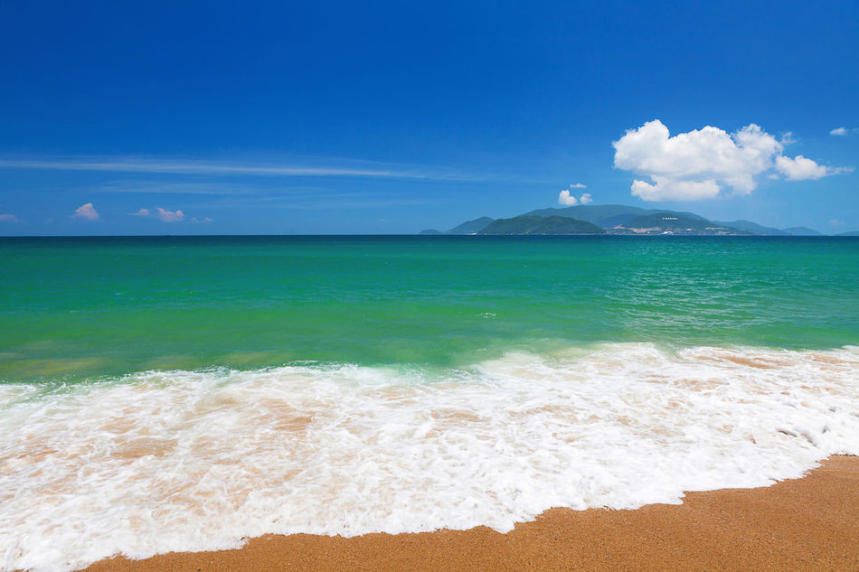 Clear blue sky over emerald South China Sea, Nha Trang, Khanh Hoa province, Vietnam Beach Beachphotography Beauty In Nature Blue Sky Clear Sky Summer Day Emeraldcoast Emeraldgreen Holiday Horizon Over Water Idyllic Leisure No People Outdoors Relax Sand Scenics Sea Sky South China Sea Tranquility Travel Destinations Vacation Water Waves Waves, Ocean, Nature