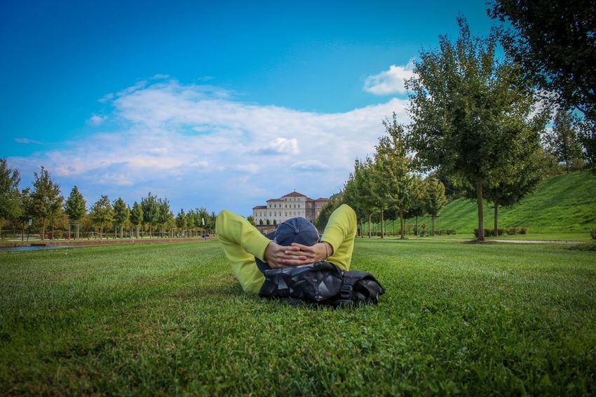 This is a pic i took for a friend of mine in the Reggia di Venaria Garden, in Venaria, a few km from Turin, I think the perspective is interesting considering this was a casual shot :) Full Length Nature Sitting Grass Tree One Person Sky Green Color Relaxation Outdoors Growth Landscape Leisure Activity Day Beauty In Nature One Man Only Men Adults Only Only Men People