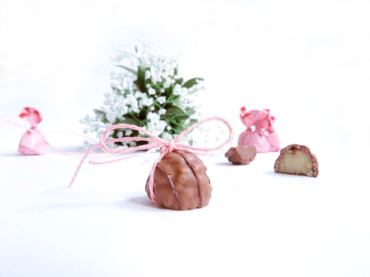 Beauty In Nature Chocolate Close-up Day Flower Flower Arrangement Flower Head Food Fragility Freshness Gift Indoors  Loop Nature No People Pink Praline Present Ready-to-eat Rosé Still Life Studio Shot Sweet Sweets White Background