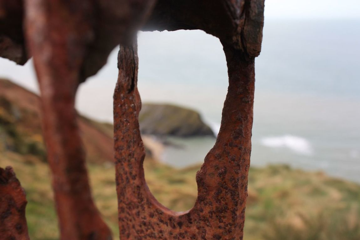 Rusty gatepost Close-up Day Sky No People Outdoors Nature Sea Water Focus On Foreground Coastal Feature