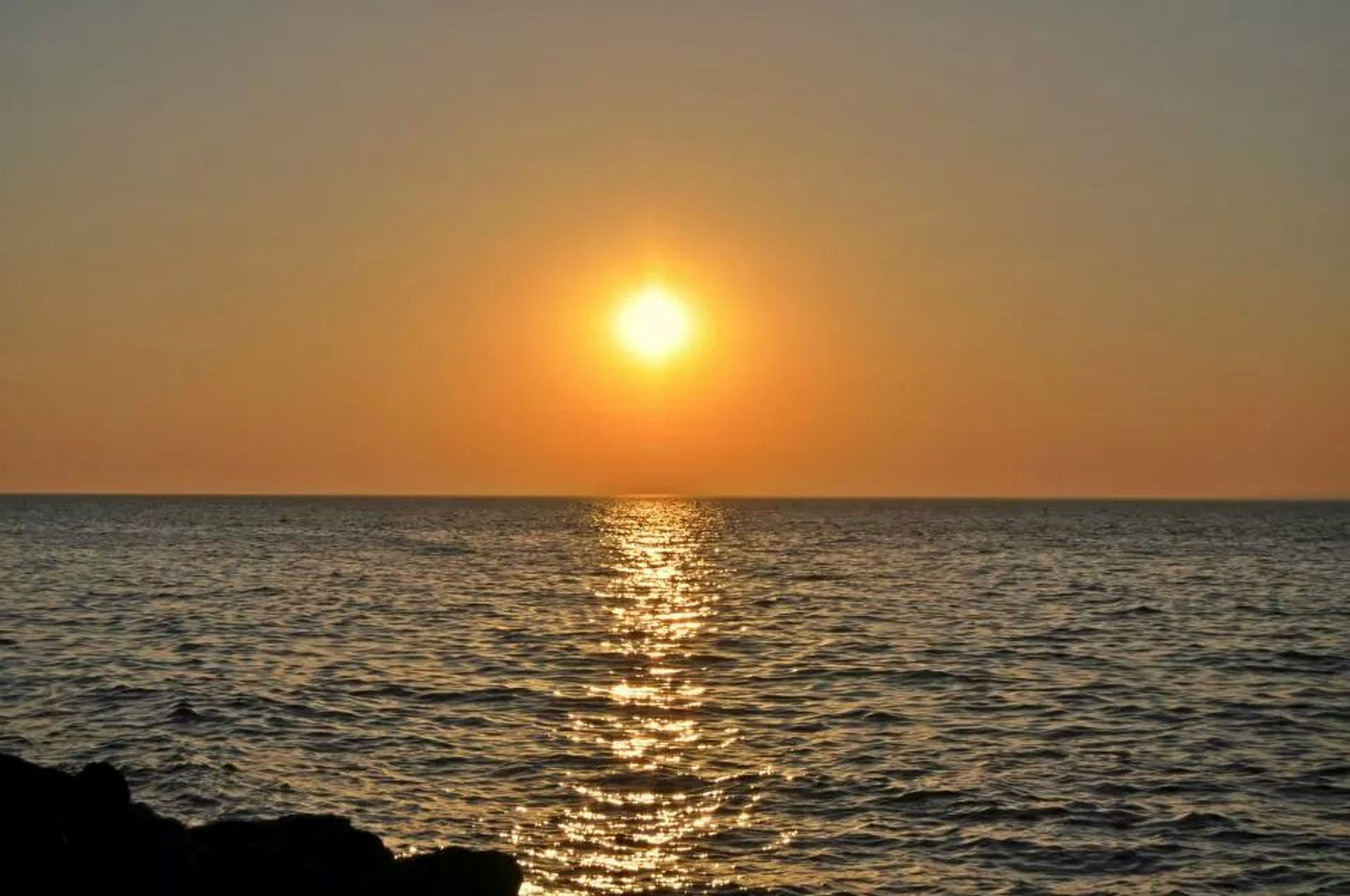 sunset, sea, water, sun, horizon over water, scenics, tranquil scene, beauty in nature, tranquility, orange color, idyllic, waterfront, nature, reflection, rippled, sky, sunlight, silhouette, clear sky, seascape