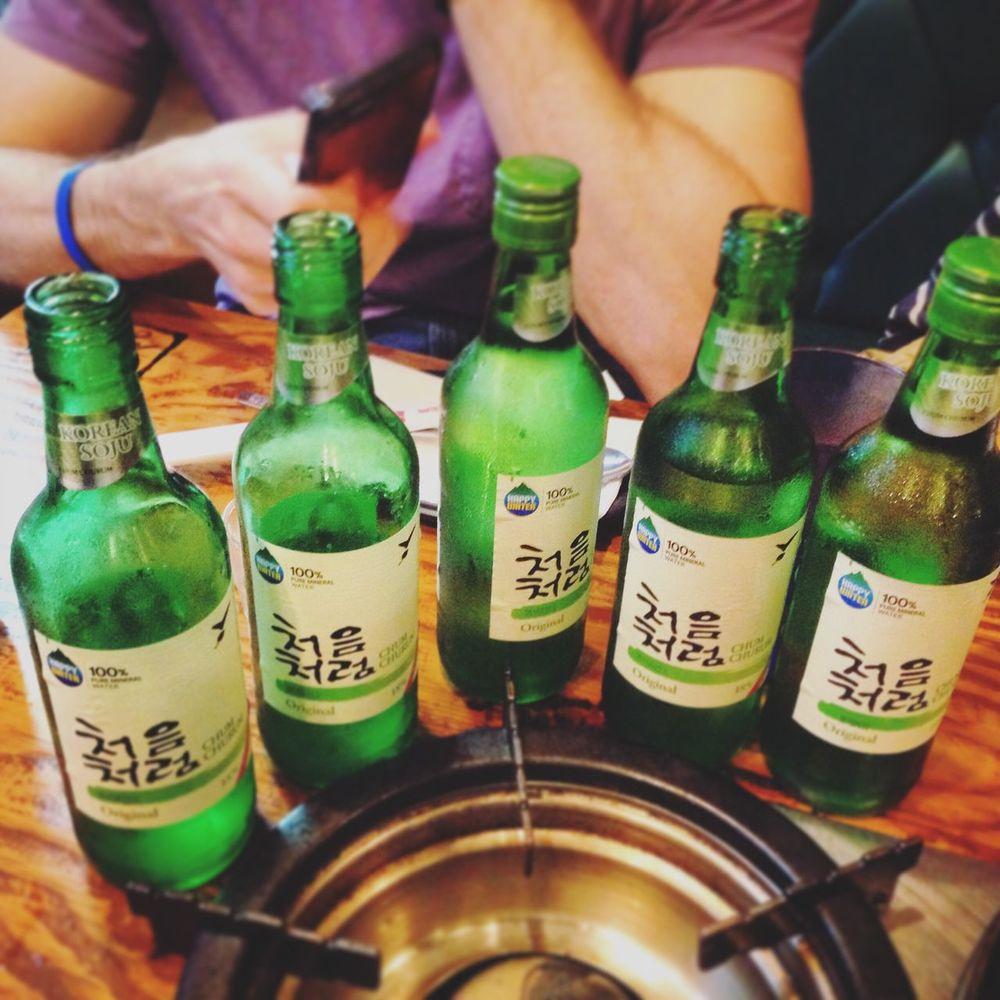 ShareTheMeal Bottle Alcohol Food And Drink Beer Bottle Green Color Close-up Winetasting Soju Shots Soju Korean BBQ Celebration Shots Anniversary College Life Responsible Drinking