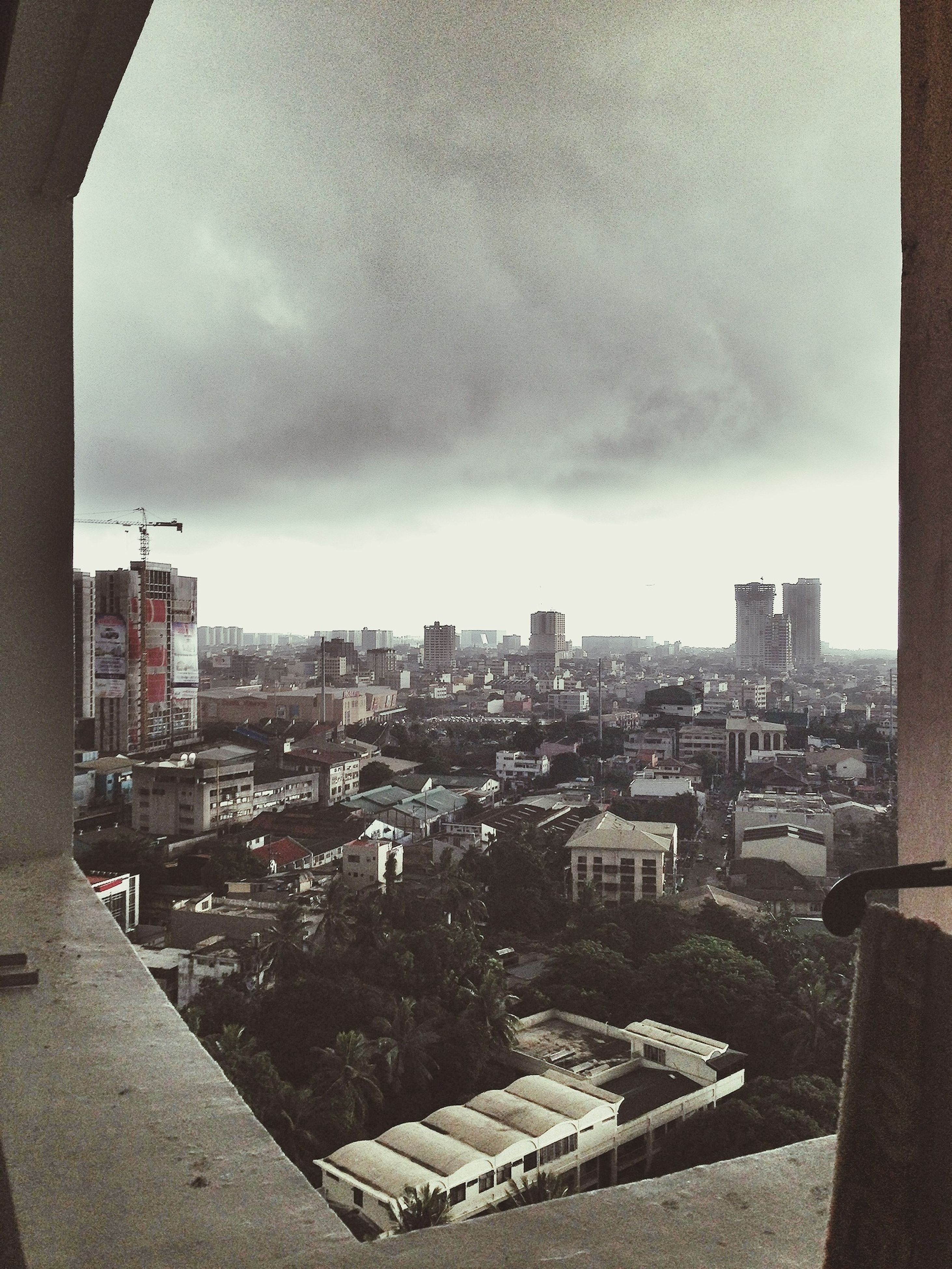 building exterior, architecture, built structure, sky, cityscape, city, cloud - sky, cloudy, residential building, residential district, residential structure, weather, crowded, high angle view, overcast, building, cloud, storm cloud, dusk, city life