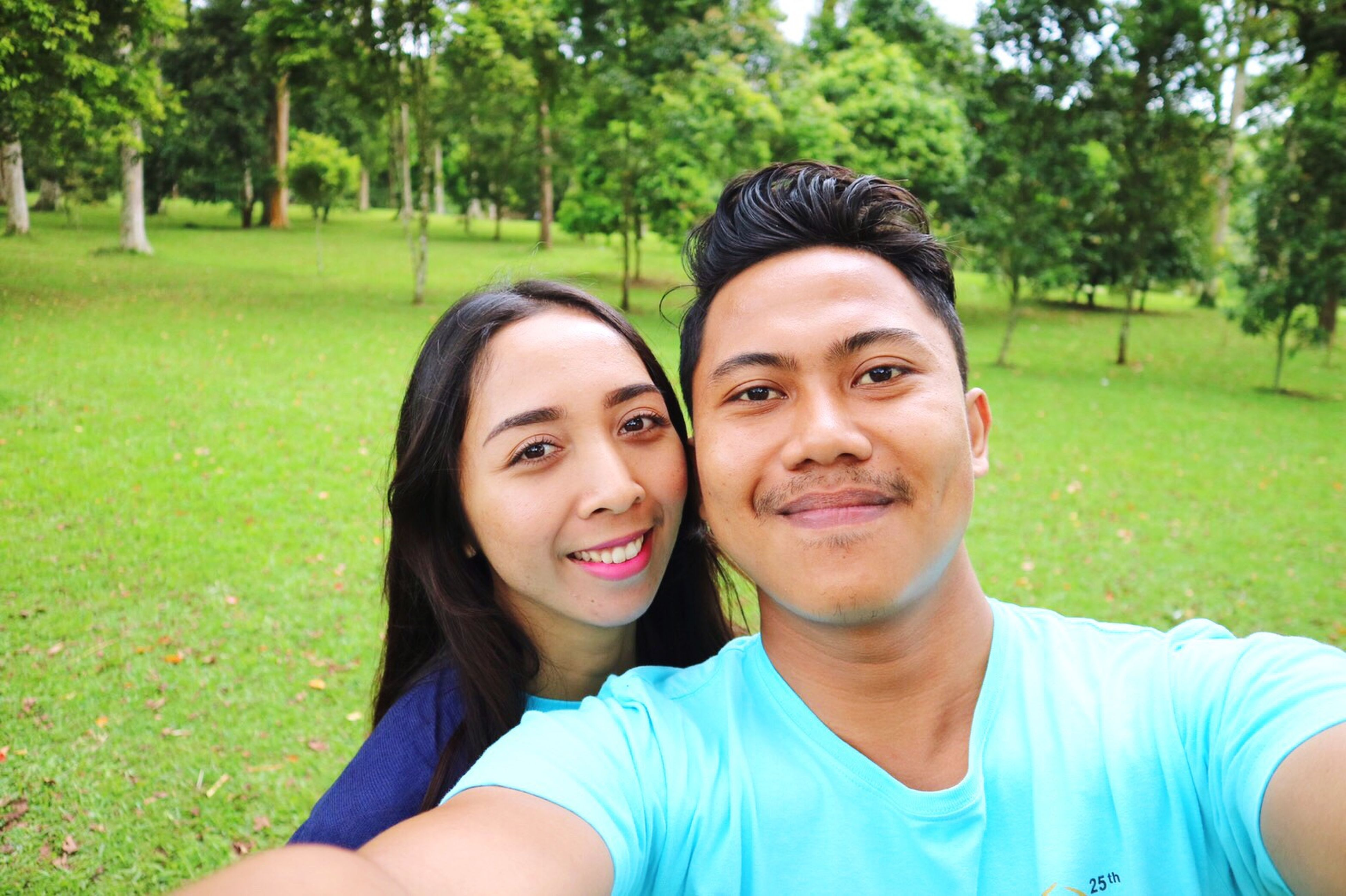 two people, looking at camera, smiling, togetherness, love, tree, portrait, selfie, happiness, grass, headshot, outdoors, day, young adult, green color, young women, cheerful, bonding, photography themes, nature, adult, people, close-up, adults only