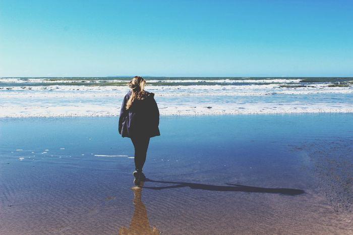 Girl Walking Towards To  The Sea Blonde Westward Ho! Ho Beach Water Sand Coast Devon Ocean Sky Reflection Blue Wave Telling Stories Differently The Secret Spaces
