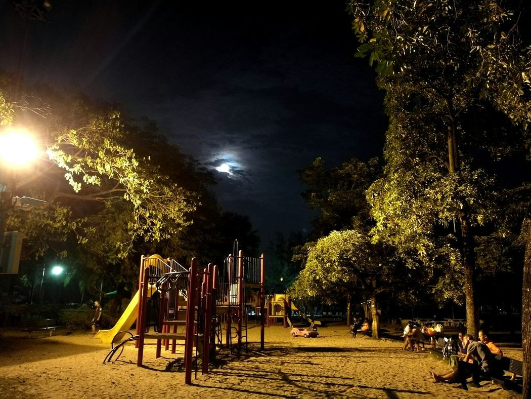 Tree Night People And Places No People Illuminated Sky Outdoors Park Lumpini Park Playground Playground Fun With The Kids Moonshine Moon Moonlight Drawn By Clouds Moonshot Dramatic Sky Cloud - Sky Clounds And Sky