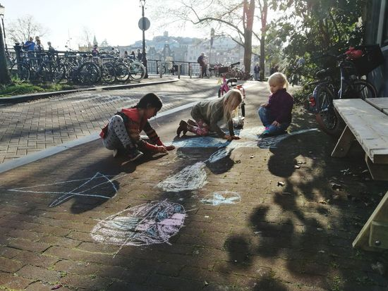 City Walking Around Autumn Celebrate The Moment Children Playing Girls Tree Playing On The Streets Children Only Childhood Real People Celebrate The Little Things Netherlands Amsterdam Drawing Drawing On The Pavement