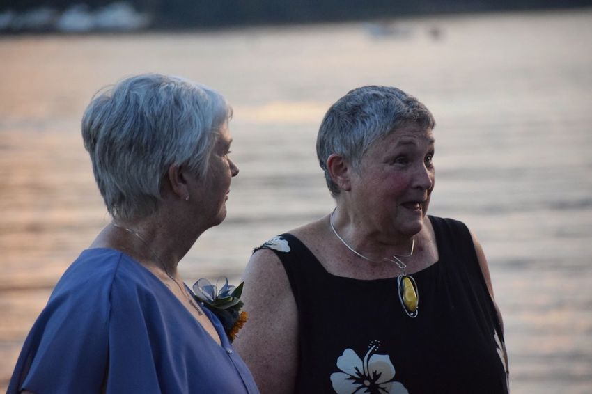 EyeEm Selects Real People Two People Togetherness Focus On Foreground Senior Adult Outdoors Love Day Leisure Activity Lifestyles Mature Women Senior Women Headshot Sisters River Sunset Women Nature Water Close-up