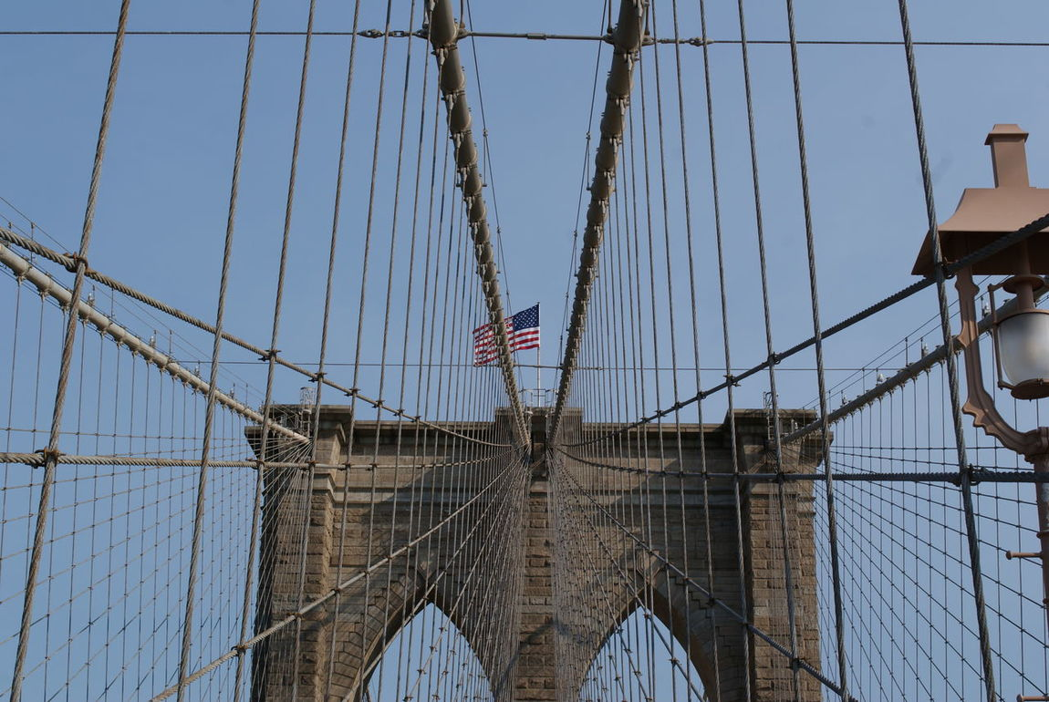 Architecture Bridge - Man Made Structure Brooklyn Bridge / New York Built Structure Close-up Day Flag Low Angle View New York No People Outdoors Patriotism Sky Suspension Bridge United States US Flag